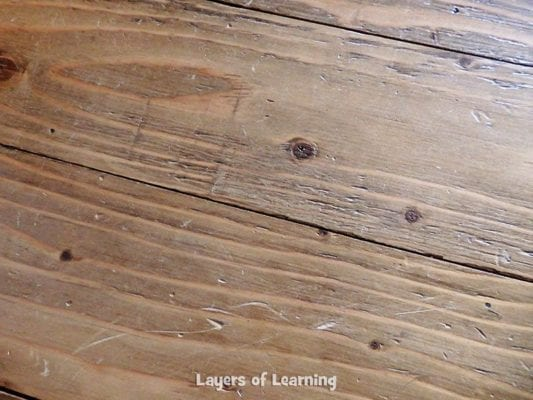 Close up of plywood floors after three years