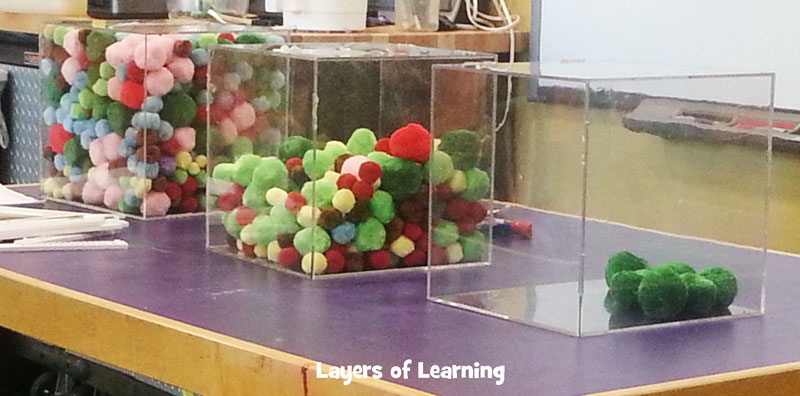 pom poms in a container showing states of matter