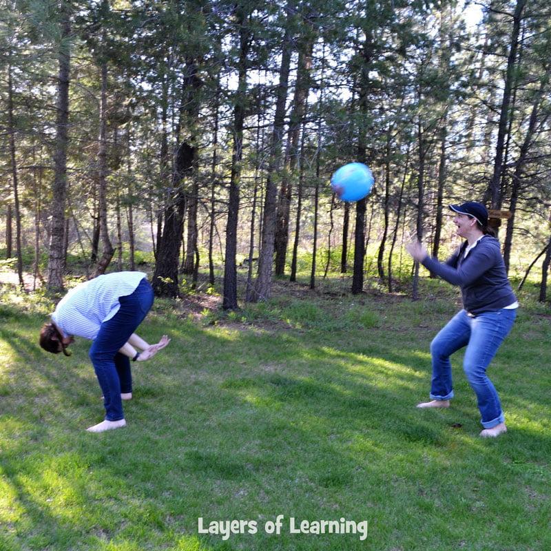 Karen and Michelle tossing a globe beach ball